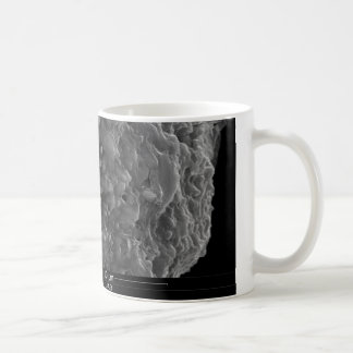A close up view of a pipe cross section coffee mug