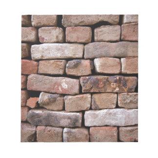 A closer look to a brick wall notepad