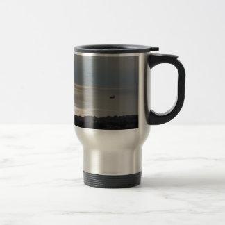 A cloudy sea and a setting sun coffee mug