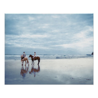 A couple riding horses on Parkiri beach in New Poster
