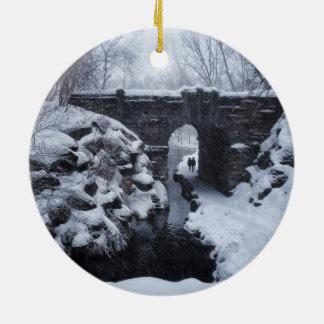 A Couple Walking Under a Snowy Glen Span Arch Ceramic Ornament