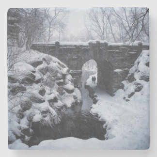 A Couple Walking Under a Snowy Glen Span Arch Stone Coaster