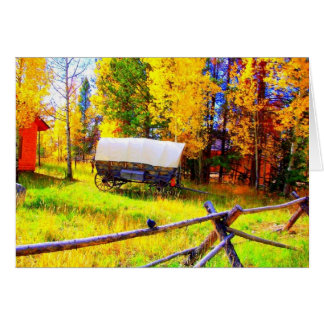 A covered wagon in a Fall Setting in Colorado Card
