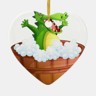 A crocodile taking a bath ceramic heart decoration
