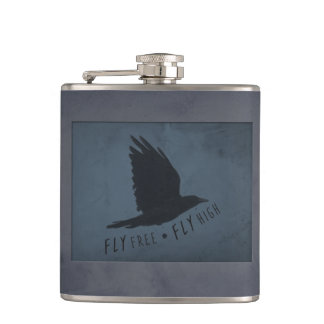 A Crow in Flight on Grungy Blue & Gray Background Hip Flask