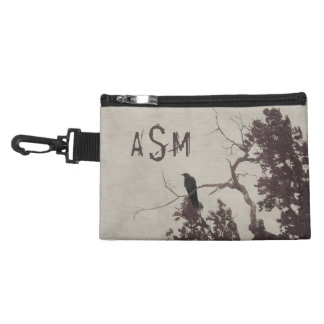 A Crow on a Branch in a Tree with Burgundy Leaves Accessories Bags