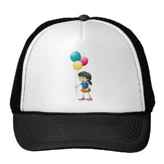 A cute litte girl holding balloons cap