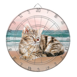 A Cuter Striped Cat Sitting on Beach with sunset Dartboards
