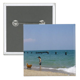 A day frolicking on the beach 15 cm square badge