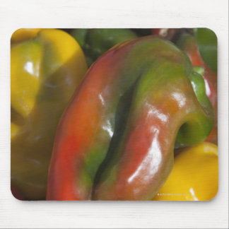 a display of colourful peppers for sale at the mousepad