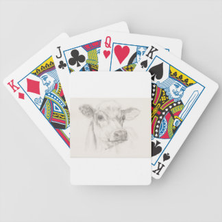 A drawing of a young cow bicycle playing cards