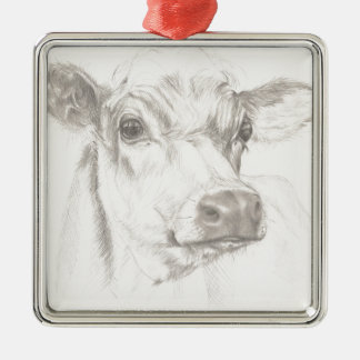 A drawing of a young cow metal ornament
