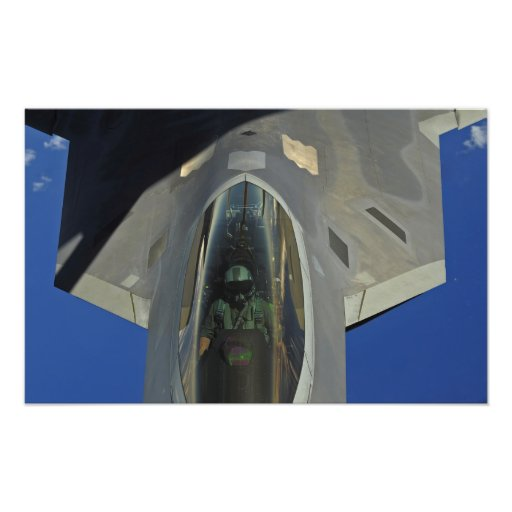A F-22 Raptor receives fuel from a KC-135 Photograph