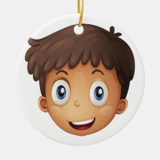 A face of a boy christmas ornament