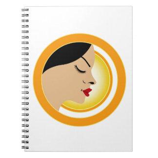 A face with a bright yellow sun- Sun tan Notebook
