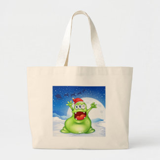 A fat green monster wearing a red Santa hat Large Tote Bag