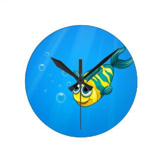 A fish swimming in the sea wall clocks