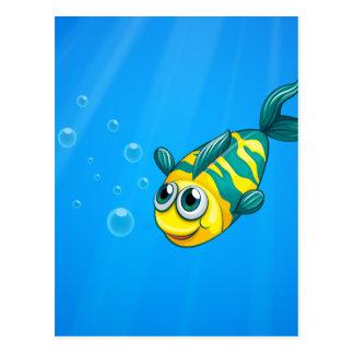 A fish swimming in the sea postcard