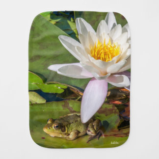 A frog under a flower burp cloth