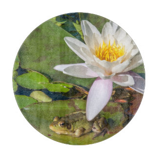 A frog under a flower of water lily cutting board