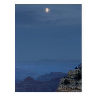 A full moon rises through a dusk sky at Hopi Postcard