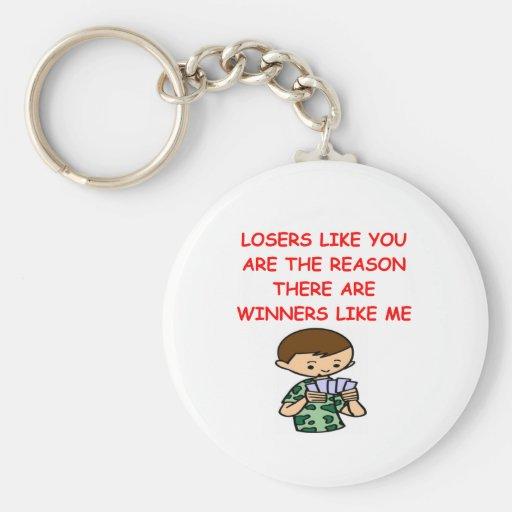 a funny winners and losers joke key chain