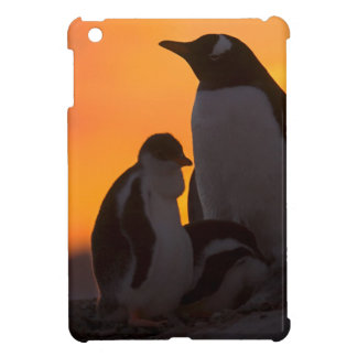 A gentoo penguin adult and chick are silhouetted iPad mini cases