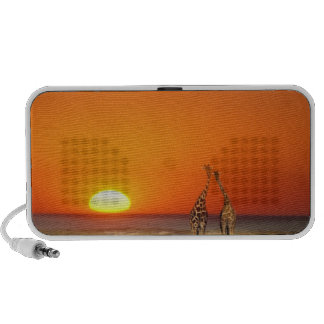 A Giraffe couple walks into the sunset, in Portable Speakers