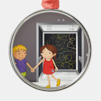 A girl and a boy holding hands near the elevator metal ornament