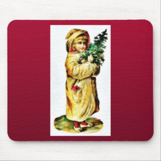 A girl praying with christmas tree on hand mousepads