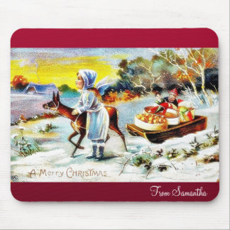 A girl praying with handle infront of christmas tr mousepad