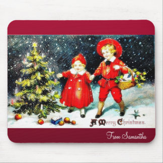 A girl praying with handle infront of christmas tr mousepads