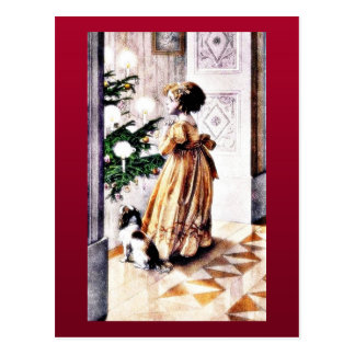 A girl with a dog praying infront of christmas tre postcard