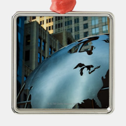 A globe with a stainless steel North America Christmas Ornament