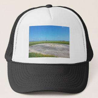 a grassy plain trucker hat