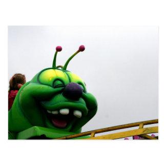 A green caterpillar goofy fair ride image postcard