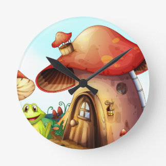 A green frog near a mushroom house round clock