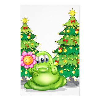A green monster holding a smiling flower stationery design