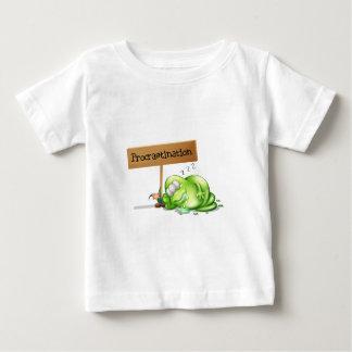 A green monster procrastinating beside a signboard shirt