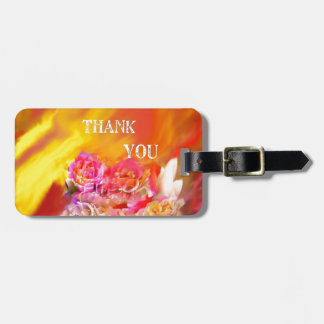 A hand full of thanks tends toward you. luggage tag