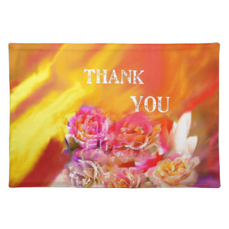 A hand full of thanks tends toward you. placemat