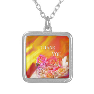 A hand full of thanks tends toward you. silver plated necklace