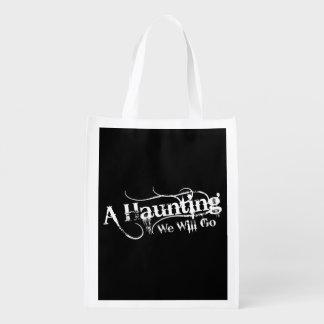 A Haunting We Will Go LLC White Logo Black Back