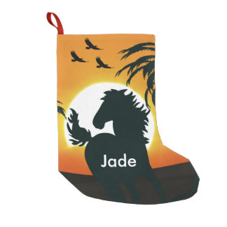 A horse silhouette at sunset small christmas stocking