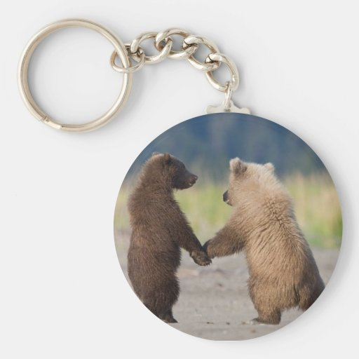 A key chain of two bears holding hands