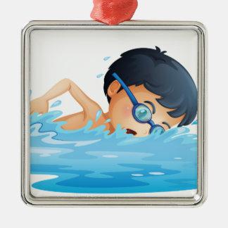 A kid swimming metal ornament