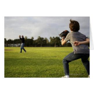 A kid wearing a baseball glove waits for his dad greeting card