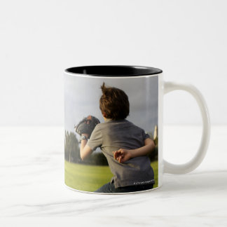A kid wearing a baseball glove waits for his dad Two-Tone mug