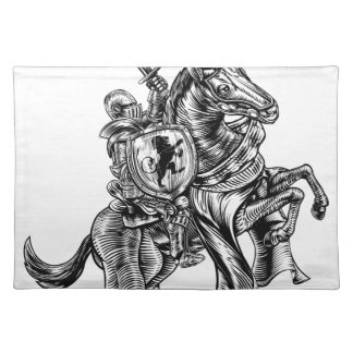 A knight holding a sword and shield on the back of placemat