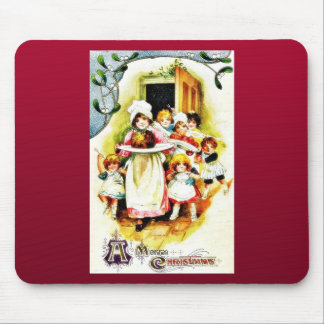 A lady comes with christmas cake and kids around h mouse pad